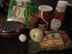 picture of ground turkey, bread crumbs, sriracha, ketchup, egg, onion and chopped bell peppers